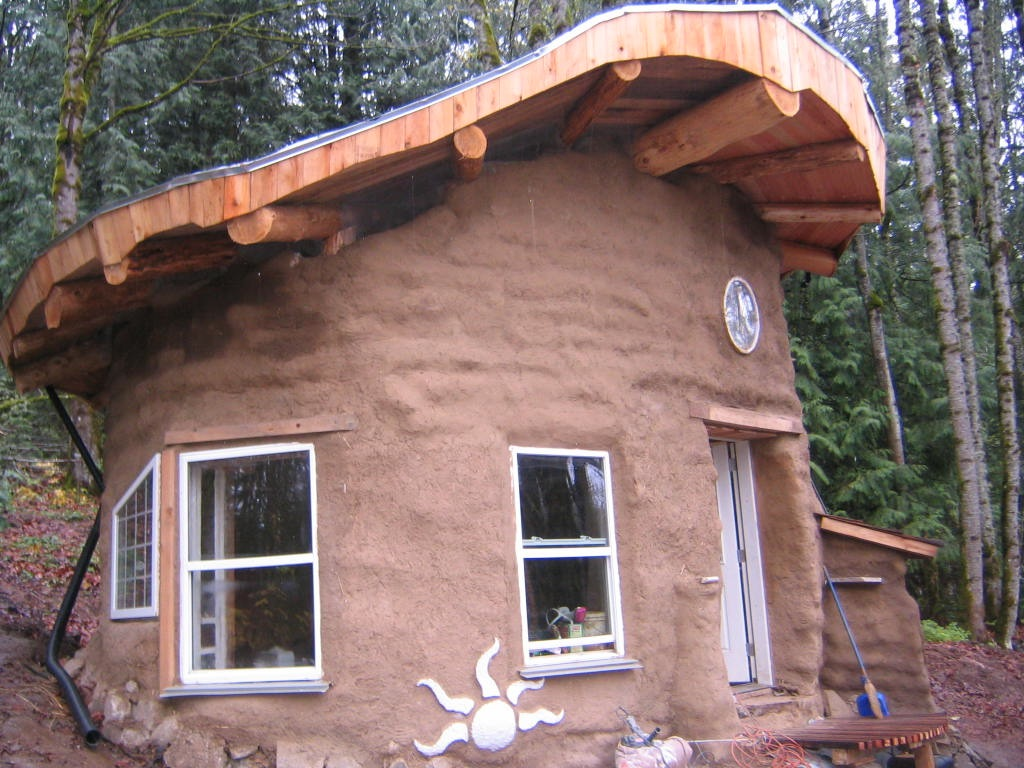Earthen hand building sustainably by teaching for Cheapest construction method